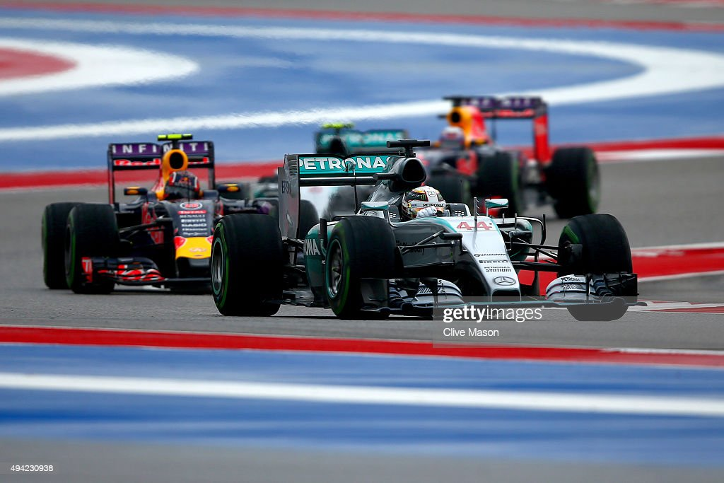 Lewis Hamilton of Great Britain and Mercedes GP leads Daniil Kvyat of Russia and Infiniti Red Bull Racing Nico Rosberg of Germany and Mercedes GP and...