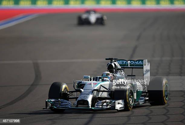 Lewis Hamilton of Great Britain and Mercedes GP leads during the Russian Formula One Grand Prix at Sochi Autodrom on October 12 2014 in Sochi Russia