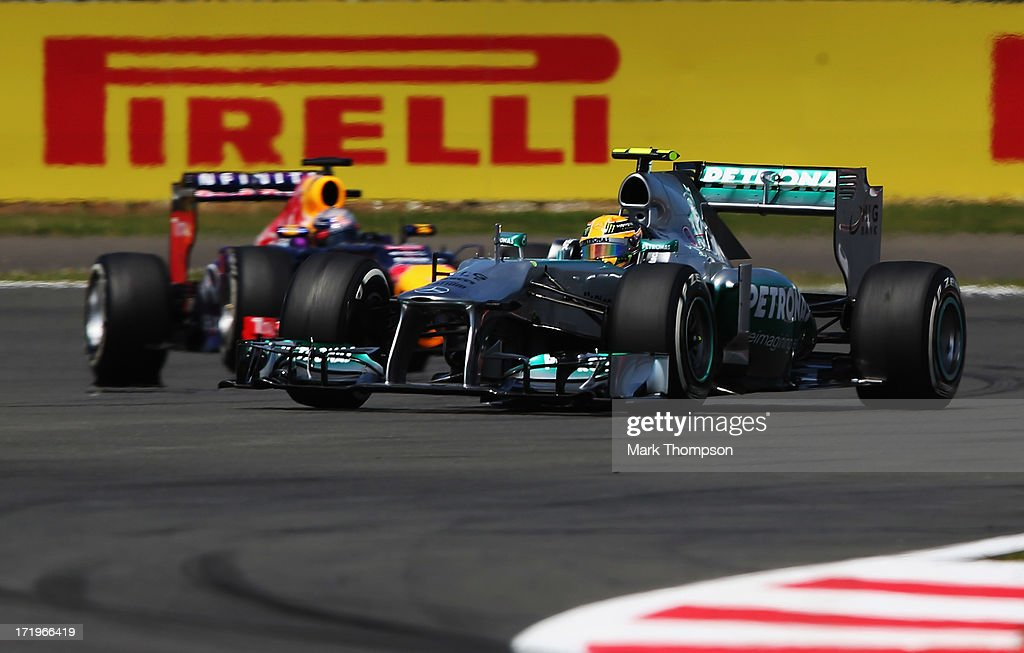 Lewis Hamilton of Great Britain and Mercedes GP leads from Sebastian Vettel of Germany and Infiniti Red Bull Racing at the start of the British Formula One Grand Prix at Silverstone Circuit on June 30, 2013 in Northampton, England.