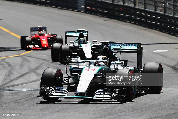 Lewis Hamilton of Great Britain and Mercedes GP leads from team mate Nico Rosberg of Germany and Mercedes GP and Sebastian Vettel of Germany and...