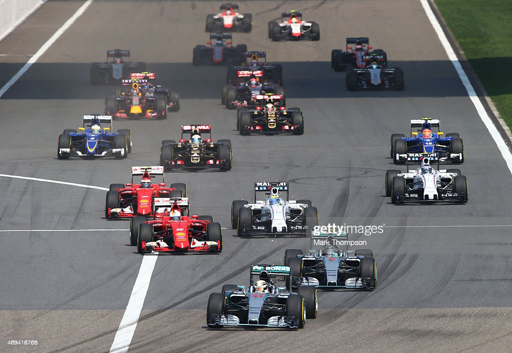 Lewis Hamilton of Great Britain and Mercedes GP leads into the first corner during the Formula One Grand Prix of China at Shanghai International...