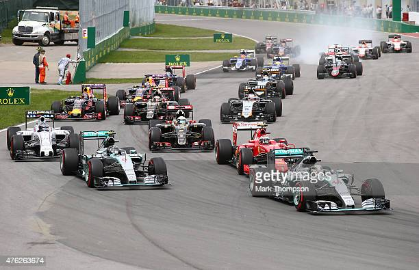 Lewis Hamilton of Great Britain and Mercedes GP leads into the first corner during the Canadian Formula One Grand Prix at Circuit Gilles Villeneuve...
