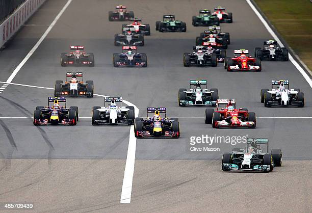 Lewis Hamilton of Great Britain and Mercedes GP leads into the first corner during the Chinese Formula One Grand Prix at the Shanghai International...