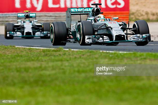 Lewis Hamilton of Great Britain and Mercedes GP leads Nico Rosberg of Germany and Mercedes GP during the Hungarian Formula One Grand Prix at...