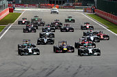 Lewis Hamilton of Great Britain and Mercedes GP leads Nico Rosberg of Germany and Mercedes GP and Sebastian Vettel of Germany and Infiniti Red Bull...