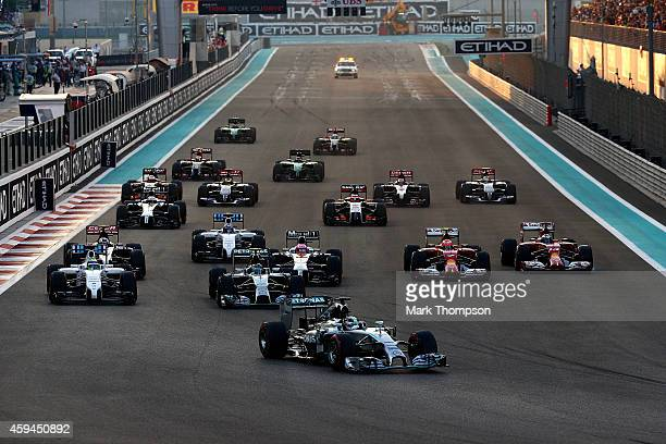 Lewis Hamilton of Great Britain and Mercedes GP leads Nico Rosberg of Germany and Mercedes GP and the rest if the field into the first turn during...