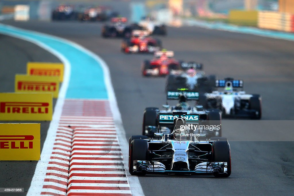 Lewis Hamilton of Great Britain and Mercedes GP leads Nico Rosberg of Germany and Mercedes GP during the Abu Dhabi Formula One Grand Prix at Yas...