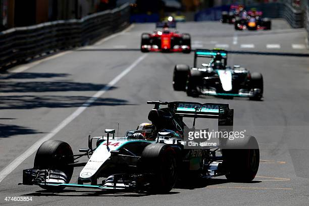 Lewis Hamilton of Great Britain and Mercedes GP leads Nico Rosberg of Germany and Mercedes GP during the Monaco Formula One Grand Prix at Circuit de...