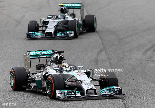 Lewis Hamilton of Great Britain and Mercedes GP leads Nico Rosberg of Germany and Mercedes GP during the Spanish Formula One Grand Prix at Circuit de...