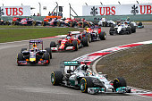 Lewis Hamilton of Great Britain and Mercedes GP leads Sebastian Vettel of Germany and Infiniti Red Bull Racing and Fernando Alonso of Spain and...