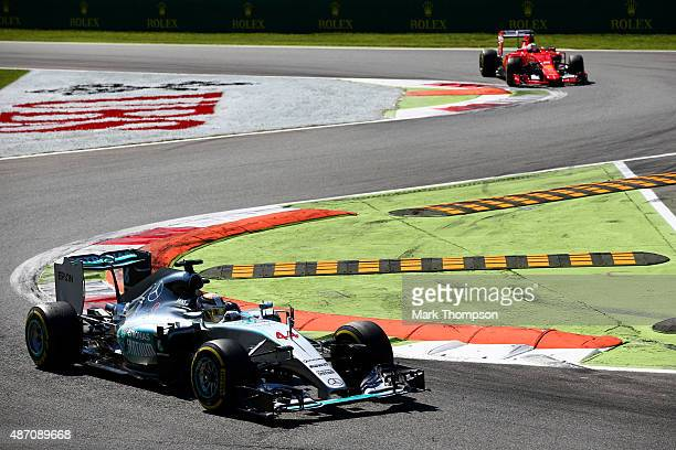 Lewis Hamilton of Great Britain and Mercedes GP leads Sebastian Vettel of Germany and Ferrari during the Formula One Grand Prix of Italy at Autodromo...