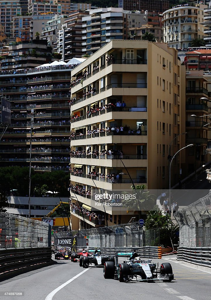 Lewis Hamilton of Great Britain and Mercedes GP leads team mate Nico Rosberg of Germany and Mercedes GP up the hill at the start of the Monaco Formula One Grand Prix at Circuit de Monaco on May 24, 2015 in Monte-Carlo, Monaco.