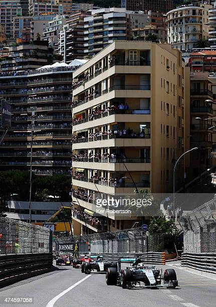 Lewis Hamilton of Great Britain and Mercedes GP leads team mate Nico Rosberg of Germany and Mercedes GP up the hill at the start of the Monaco...