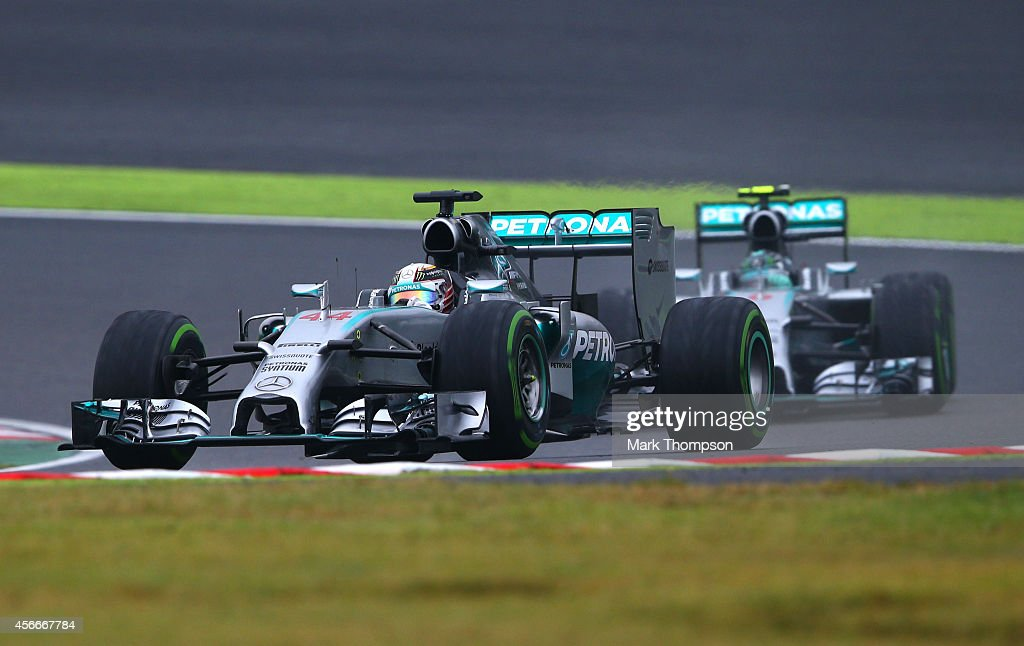Lewis Hamilton of Great Britain and Mercedes GP leads teammate Nico Rosberg of Germany and Mercedes GP during the Japanese Formula One Grand Prix at...