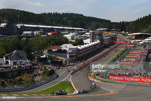Lewis Hamilton of Great Britain and Mercedes GP leads the field at the start of the Formula One Grand Prix of Belgium at Circuit de SpaFrancorchamps...