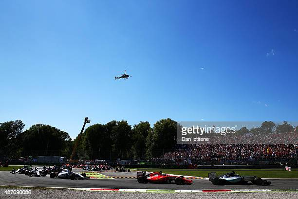Lewis Hamilton of Great Britain and Mercedes GP leads the field at the start of the Formula One Grand Prix of Italy at Autodromo di Monza on...