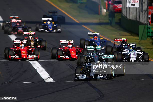 Lewis Hamilton of Great Britain and Mercedes GP leads the field into the first corner during the Australian Formula One Grand Prix at Albert Park on...