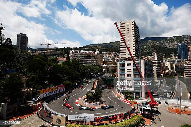 Lewis Hamilton of Great Britain and Mercedes GP leads the field round the hairpin at the start of the Monaco Formula One Grand Prix at Circuit de...
