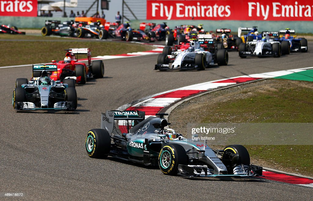 Lewis Hamilton of Great Britain and Mercedes GP leads the field during the Formula One Grand Prix of China at Shanghai International Circuit on April...