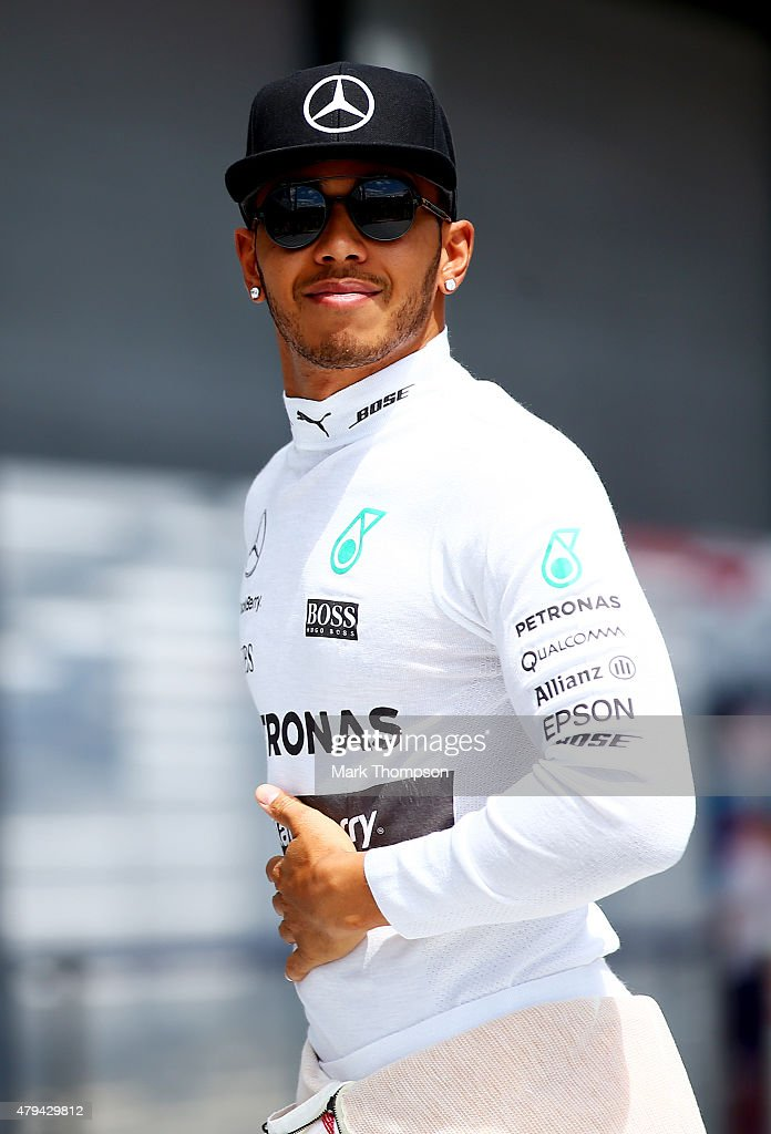 <a gi-track='captionPersonalityLinkClicked' href=/galleries/search?phrase=Lewis+Hamilton&family=editorial&specificpeople=586983 ng-click='$event.stopPropagation()'>Lewis Hamilton</a> of Great Britain and Mercedes GP leaves the team motorhome as he walks to the garage for qualifying for the Formula One Grand Prix of Great Britain at Silverstone Circuit on July 4, 2015 in Northampton, England.
