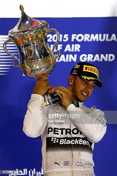 Lewis Hamilton of Great Britain and Mercedes GP lifts the trophy on the podium after winning the Bahrain Formula One Grand Prix at Bahrain...