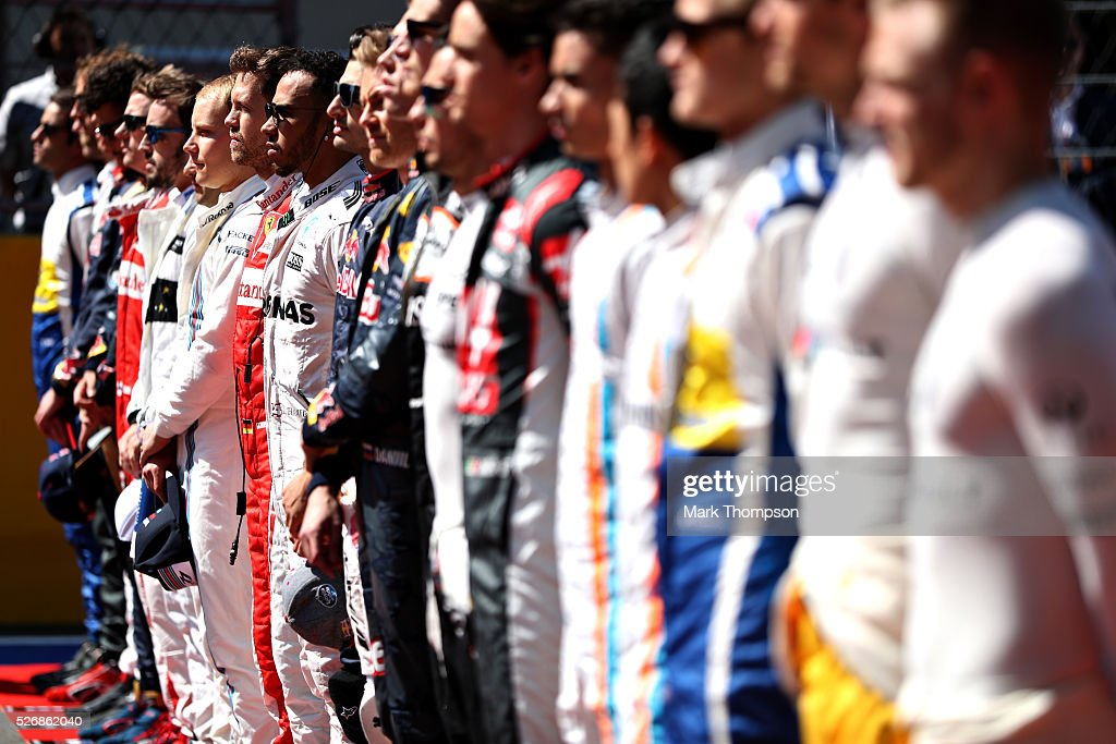 <a gi-track='captionPersonalityLinkClicked' href=/galleries/search?phrase=Lewis+Hamilton&family=editorial&specificpeople=586983 ng-click='$event.stopPropagation()'>Lewis Hamilton</a> of Great Britain and Mercedes GP lines up for the national anthem next to <a gi-track='captionPersonalityLinkClicked' href=/galleries/search?phrase=Sebastian+Vettel&family=editorial&specificpeople=2233605 ng-click='$event.stopPropagation()'>Sebastian Vettel</a> of Germany and Ferrari during the Formula One Grand Prix of Russia at Sochi Autodrom on May 1, 2016 in Sochi, Russia.