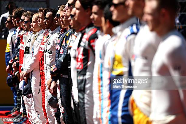 Lewis Hamilton of Great Britain and Mercedes GP lines up for the national anthem next to Sebastian Vettel of Germany and Ferrari during the Formula...