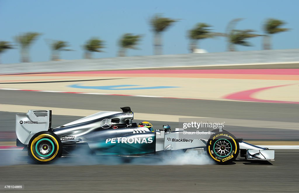 Lewis Hamilton of Great Britain and Mercedes GP locks up as he brakes while driving during day four of Formula One Winter Testing at the Bahrain International Circuit on March 2, 2014 in Bahrain, Bahrain.