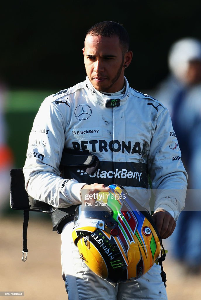 Lewis Hamilton of Great Britain and Mercedes GP looks on after crashing into the gravel at turn six during Formula One winter testing at Circuito de Jerez on February 6, 2013 in Jerez de la Frontera, Spain.