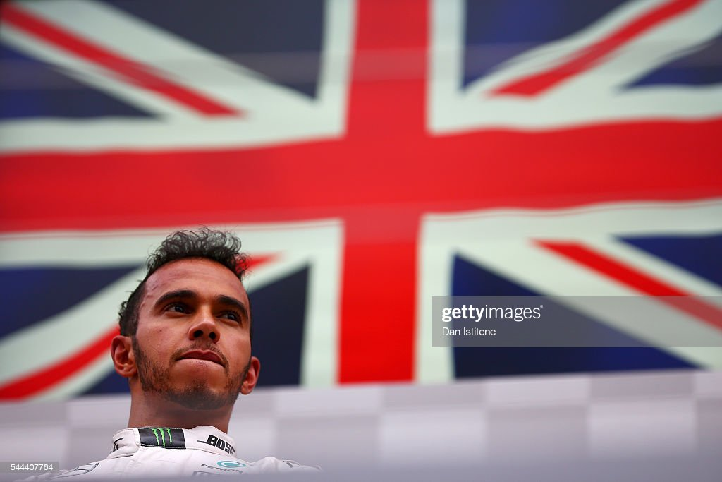 Lewis Hamilton of Great Britain and Mercedes GP looks on from the podium after winning the Formula One Grand Prix of Austria at Red Bull Ring on July...