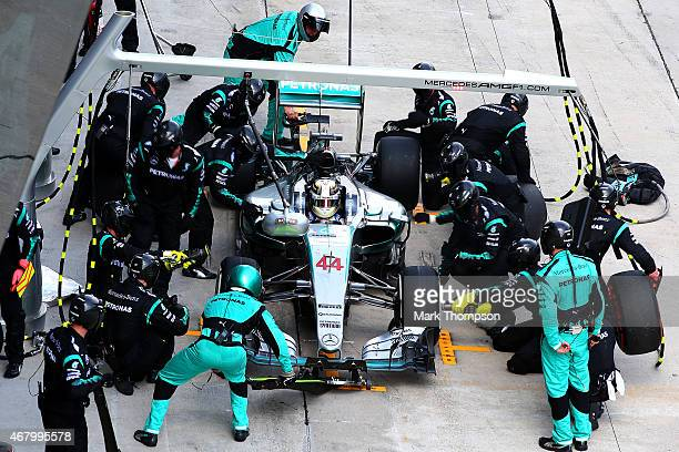 Lewis Hamilton of Great Britain and Mercedes GP makes a pit stop during the Malaysia Formula One Grand Prix at Sepang Circuit on March 29 2015 in...