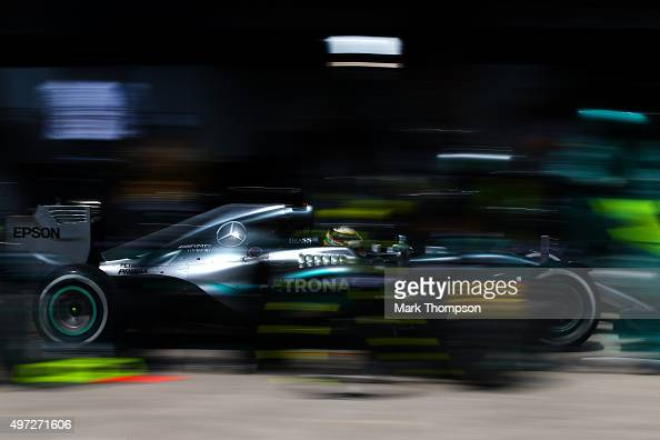 Lewis Hamilton of Great Britain and Mercedes GP makes a pit stop during the Formula One Grand Prix of Brazil at Autodromo Jose Carlos Pace on...