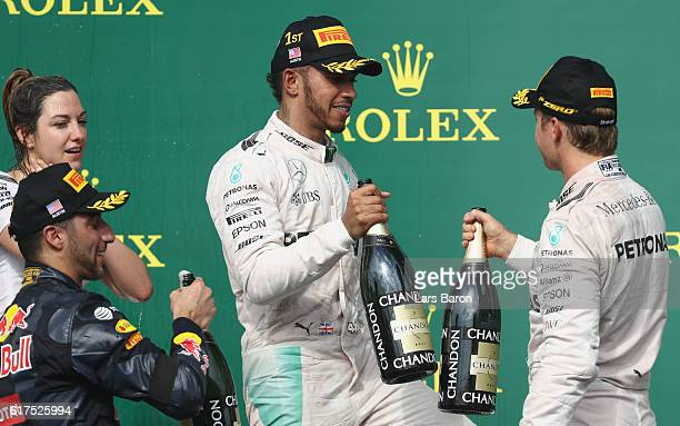 Lewis Hamilton of Great Britain and Mercedes GP Nico Rosberg of Germany and Mercedes GP and Daniel Ricciardo of Australia and Red Bull Racing...