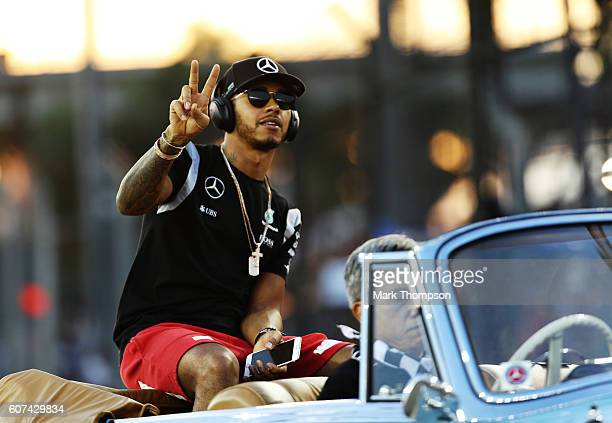 Lewis Hamilton of Great Britain and Mercedes GP on the drivers parade before the Formula One Grand Prix of Singapore at Marina Bay Street Circuit on...