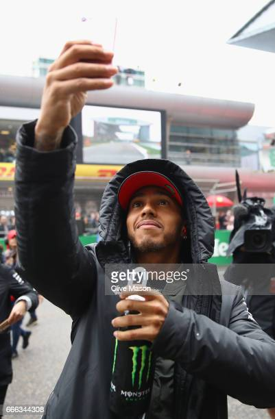 Lewis Hamilton of Great Britain and Mercedes GP on the drivers parade before the Formula One Grand Prix of China at Shanghai International Circuit on...