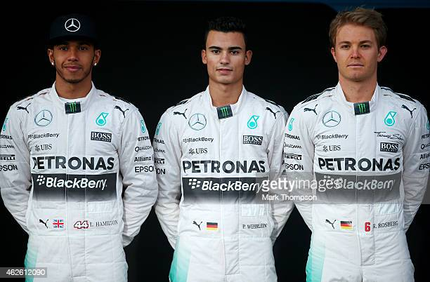 Lewis Hamilton of Great Britain and Mercedes GP Pascal Wehrlein of Germany and Mercedes GP and Nico Rosberg of Germany and Mercedes GP pose with the...
