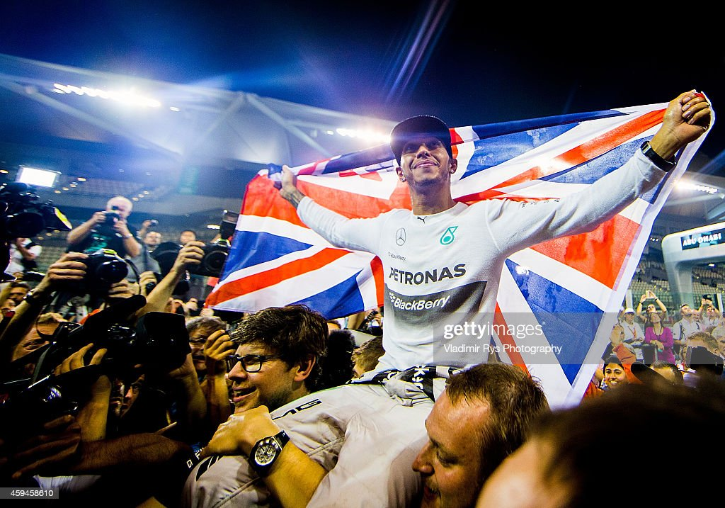 Lewis Hamilton of Great Britain and Mercedes GP Petronas is celebrated by his team after becoming World Champion following his win during the Abu...