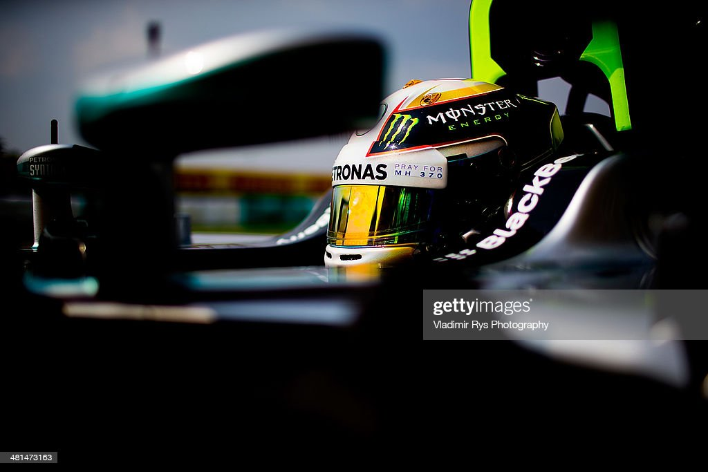 Lewis Hamilton of Great Britain and Mercedes GP Petronas sits in his car on the grid prior to the Malaysian Formula One Grand Prix at Sepang International Circuit on March 30, 2014 in Kuala Lumpur, Malaysia.