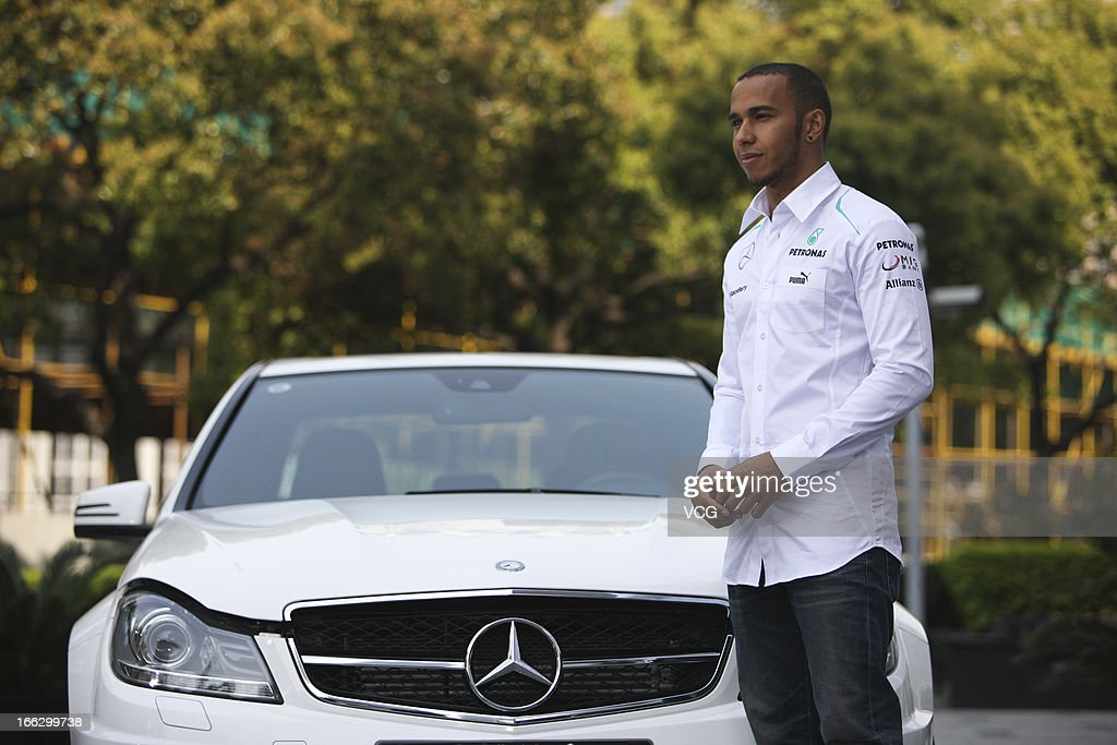 <a gi-track='captionPersonalityLinkClicked' href=/galleries/search?phrase=Lewis+Hamilton+-+Racecar+Driver&family=editorial&specificpeople=586983 ng-click='$event.stopPropagation()'>Lewis Hamilton</a> of Great Britain and Mercedes GP poses during the filming of a Mercedes-Benz advertisment in front of Jin Mao Tower on April 10, 2013 in Shanghai, China.