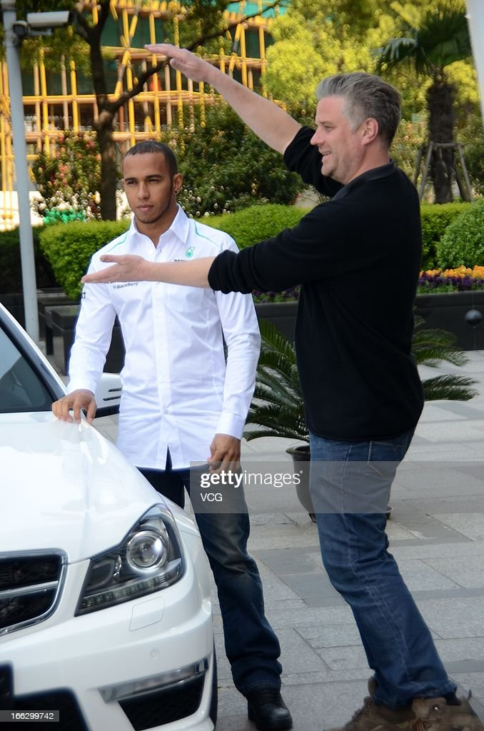 Lewis Hamilton of Great Britain and Mercedes GP poses during the filming of a Mercedes-Benz advertisment in front of Jin Mao Tower on April 10, 2013 in Shanghai, China.
