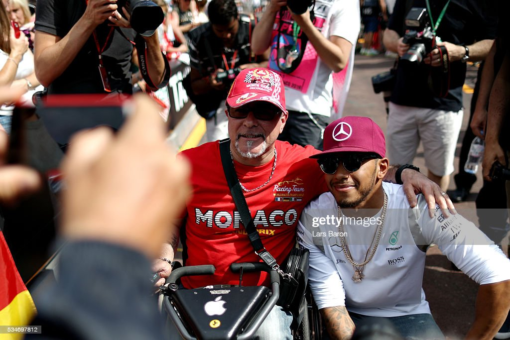 Lewis Hamilton of Great Britain and Mercedes GP poses for a photo with a fan during previews to the Monaco Formula One Grand Prix at Circuit de Monaco on May 27, 2016 in Monte-Carlo, Monaco.