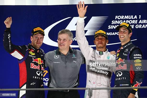 Lewis Hamilton of Great Britain and Mercedes GP poses with Sebastian Vettel of Germany and Infiniti Red Bull Racing and Daniel Ricciardo of Australia...