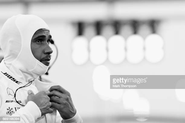 Lewis Hamilton of Great Britain and Mercedes GP prepares on the grid during the Bahrain Formula One Grand Prix at Bahrain International Circuit on...