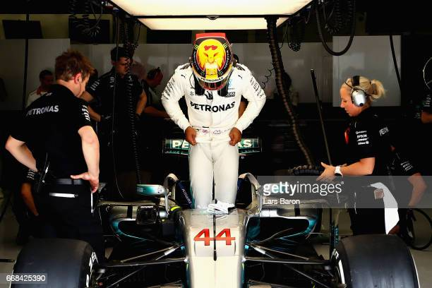 Lewis Hamilton of Great Britain and Mercedes GP prepares to drive in the garage during practice for the Bahrain Formula One Grand Prix at Bahrain...