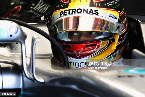 Lewis Hamilton of Great Britain and Mercedes GP prepares to drive in the garage during final practice for the Bahrain Formula One Grand Prix at...