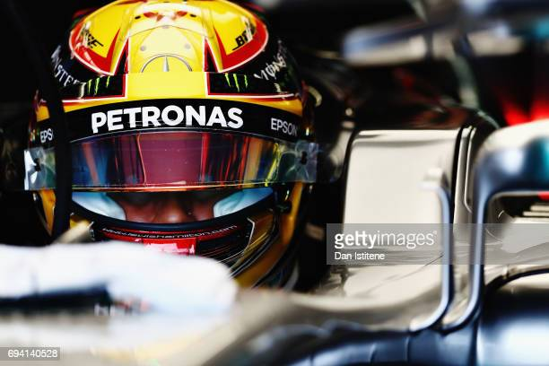 Lewis Hamilton of Great Britain and Mercedes GP prepares to drive in the garage during practice for the Canadian Formula One Grand Prix at Circuit...
