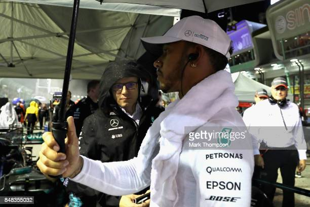 Lewis Hamilton of Great Britain and Mercedes GP prepares to drive on the grid before the Formula One Grand Prix of Singapore at Marina Bay Street...