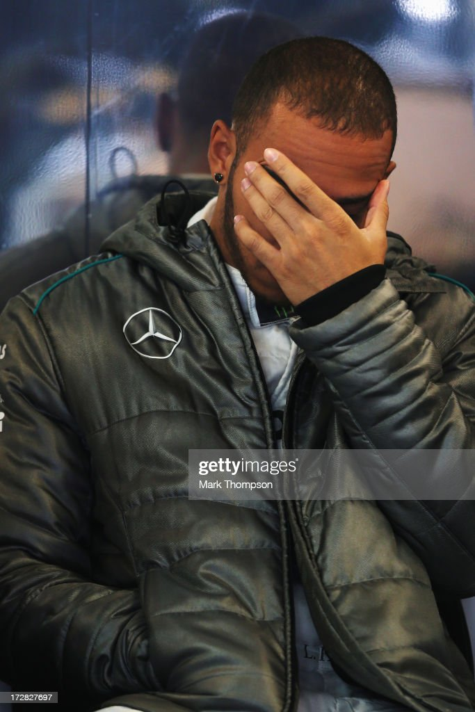 <a gi-track='captionPersonalityLinkClicked' href=/galleries/search?phrase=Lewis+Hamilton+-+Racecar+Driver&family=editorial&specificpeople=586983 ng-click='$event.stopPropagation()'>Lewis Hamilton</a> of Great Britain and Mercedes GP prepares to drive during practice for the German Grand Prix at the Nuerburgring on July 5, 2013 in Nuerburg, Germany.