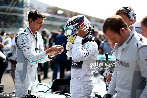 Lewis Hamilton of Great Britain and Mercedes GP puts on his helmet prior to the F1 Grand Prix of Italy at Autodromo di Monza on September 7 2014 in...