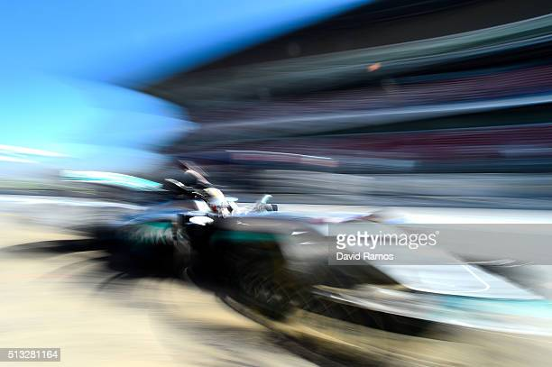 Lewis Hamilton of Great Britain and Mercedes GP returns to the garage during day two of F1 winter testing at Circuit de Catalunya on March 2 2016 in...